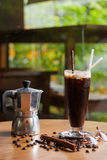 A moka pot and a cup of coffee with roasted coffee beans Stock Photos