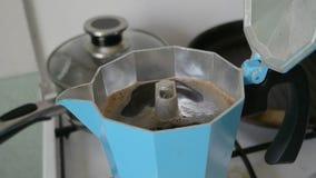 Moka pot full of espresso stock footage