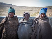 Mokhotlong, Lesotho - September 11, 2016: Three unidentified young African sheperds in traditional thick blankets. Mokhotlong, Lesotho - September 07, 2016 Royalty Free Stock Images