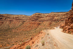 The Moki Dugway. Located on Utah Route 261 just north of Mexican Hat, Utah is a staggering, graded dirt switchback road carved into the face of the cliff edge Stock Photo