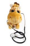 Mokiet zabawkarska żyrafa z stetoskopem Zdjęcie Royalty Free