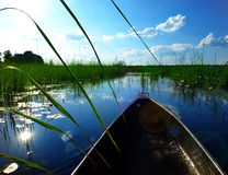 Mokoro canoe trip. Traditional tourist attraction in Botswana and northern Namibia (here - after the sunrise in Caprivi Strip Stock Image