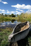 Mokoro in the Delta. Mokoro boat sitting on shore in the Okavango Delta in Botswana Royalty Free Stock Photography