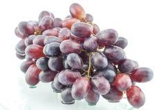Mokry grono winogrona na szkło stole Obrazy Stock