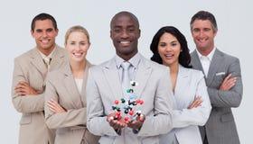 Molécules de sourire de fixation de businessteam Images stock