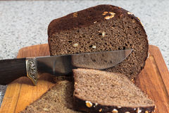 The molasses bread. Bread with nuts and a beautiful knife Royalty Free Stock Images