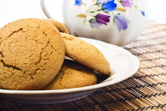 Molasses Cookies. Some molasses cookies on plate with milk pot on background Stock Image