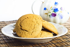 Molasses Cookies. Some molasses cookies on plate with milk pot on background Stock Photos