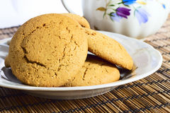 Molasses Cookies. Some molasses cookies on plate with milk pot on background Stock Images