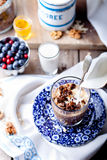 Molasses glazed oatmeal granola with milk Royalty Free Stock Photo