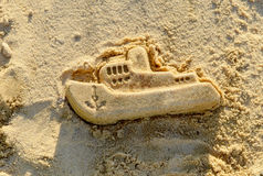 Mold boat in the sand. Kids play. Royalty Free Stock Image