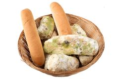 Mold on bread in the basket. Best before date has expired a long time ago with this moldy food. Isolated Background. Mold on bread in the basket. Best before royalty free stock image