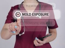MOLD EXPOSURE inscription on the screen. Close up Doctor hands holding black smart phone