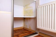Mold problem in home. Persistent mold on wall in wardrobe and shelves. Hanging heater near the corner royalty free stock photos