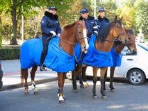 14 10 2016, Moldavië, Chisinau, politieagent drie op paarden Royalty-vrije Stock Afbeeldingen