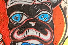 Moldavian graffiti. Detail of a graffiti in a chisinau underpass representing the stylized face of a dog red stock illustration