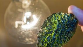 Moldavite - rzadka kopalina meteoryczny początek zdjęcie stock
