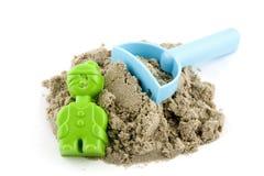 Molde con la arena y el rastrillo foto de archivo