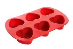 Molde dado forma coração do bolinho foto de stock