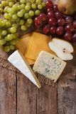 Molded cheese and fruit on the table. vertical top view Royalty Free Stock Photography