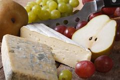 Molded cheese, grapes and pears close-up. horizontal Royalty Free Stock Image