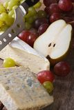 Molded cheese, grapes and pears close-up vertical Royalty Free Stock Photos