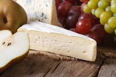 Molded cheese, grapes and pears horizontal rustic style Stock Images