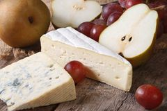 Molded cheese, red grapes and pears horizontal Royalty Free Stock Image