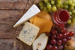 Molded cheese, wine and fruit horizontal top view closeup Royalty Free Stock Image