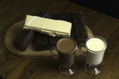 molded chocolates prepared at the table and milk drinks royalty free stock photo
