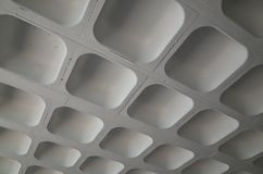 The molded concrete ceiling of a car park. Photographed to provided an abstract background Stock Photography