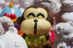 Molded plaster monkey figure. Paint molded plaster monkey figure Royalty Free Stock Images