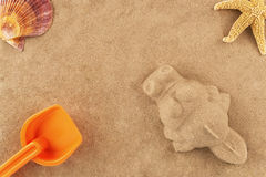 Molded sand crocodile and toy Royalty Free Stock Photo