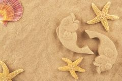 Molded sand fishes and starfish. Isolated on white background Royalty Free Stock Photography
