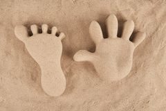 Molded sand of hand and foot. Molded sand hand and foot, top view Royalty Free Stock Images