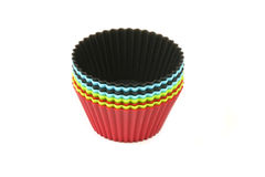 Moldes coloridos do cozimento para queques Fotografia de Stock Royalty Free