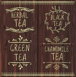 Moldes tirados chá da etiqueta do VETOR no fundo de madeira marrom Imagem de Stock Royalty Free