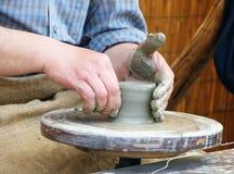 Molding the clay stock photo
