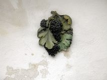 Molding in grape form on the wall. Of a winery house royalty free stock photo