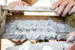Molding profile. Craftsmen made plaster moldings on the traditional method stock photos