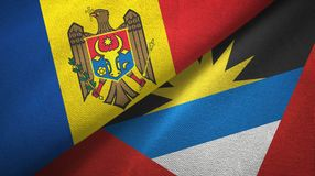Moldova and Antigua and Barbuda two flags textile cloth, fabric texture. Moldova and Antigua and Barbuda two folded flags together royalty free stock image
