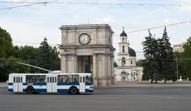 Moldova arc and bus. Triumphal arc in the park Chisinau, Moldova. Also has additional names: Sacred Gates, Arch of Victory royalty free stock photography