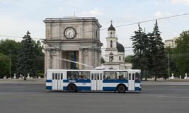 Moldova arc and bus. Triumphal arc in the park Chisinau, Moldova. Also has additional names: Sacred Gates, Arch of Victory royalty free stock image