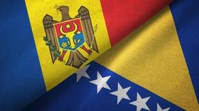Moldova, Bośnia i Herzegovina dwa flagi tekstylny płótno, tkaniny tekstura zdjęcie stock