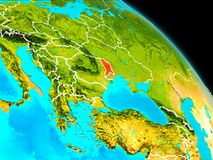 Moldova on Earth. Space orbit view of Moldova highlighted in red on planet Earth with visible borders. 3D illustration. Elements of this image furnished by NASA Royalty Free Stock Images
