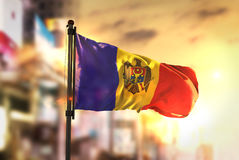 Moldova Flag Against City Blurred Background At Sunrise Backligh Stock Photography