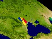 Moldova with flag on Earth Stock Image