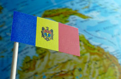 Moldova flag with a globe map as a background Royalty Free Stock Image