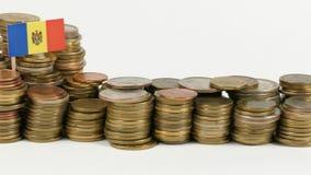 Moldova flag with stack of money coins. Moldova flag waving with stack of money coins stock footage