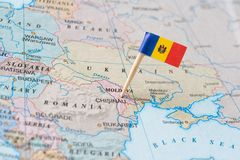 Moldova map and flag pin. Paper flag pin of Moldova on a country map showing neighboring countries. Officially the Republic of Moldova, it is a landlocked Royalty Free Stock Image